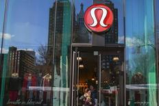 A shopper walks out of the Lululemon Athletica store in New York, December 16, 2013. REUTERS/Shannon Stapleton