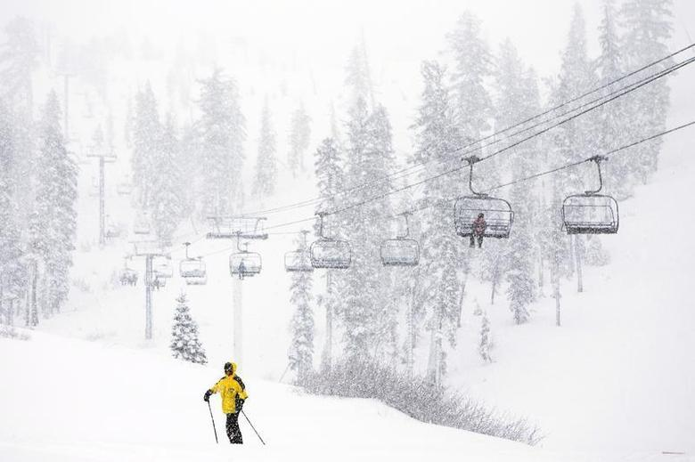 Skiers enjoy the first significant snowfall of 2014 at Sugar Bowl Ski Resort in Norden, California, February 8, 2014. REUTERS/Max Whittaker