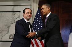 U.S. President Barack Obama (R) and French President Francois Hollande shake hands after touring the Virginia residence of Thomas Jefferson at Monticello in Charlottesville February 10, 2014. REUTERS/Larry Downing