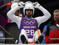 India's Shiva Keshavan prepares for the start during the men's luge training at the Sanki sliding center in Rosa Khutor, a venue for the Sochi 2014 Winter Olympics near Sochi February 5, 2014. REUTERS/Fabrizio Bensch