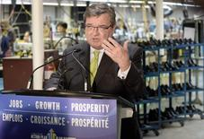 Minister of Finance Jim Flaherty speaks after trying on a new pair of shoes during a pre-budget photo opportunity at Mellow Walk Footwear in Toronto, February 7, 2014. REUTERS/Aaron Harris