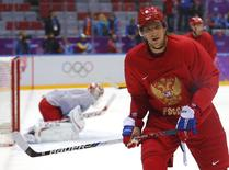 Team Russia's forward Alexander Ovechkin attends team practice in the Bolshoy Ice Dome at the 2014 Sochi Winter Olympics, February 11, 2014. REUTERS/Laszlo Balogh