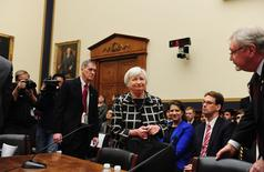 "Federal Reserve Chair Janet Yellen (C) arrives to testify before a House Financial Services Committee hearing on ""Monetary Policy and the State of the Economy."" at the Rayburn House Office Building in Washington, February 11, 2014. REUTERS/Mary F. Calvert"
