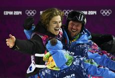 Switzerland's Iouri Podladtchikov (L) celebrates with team mates during the men's snowboard halfpipe final event at the 2014 Sochi Winter Olympic Games, in Rosa Khutor February 11, 2014. REUTERS/Dylan Martinez