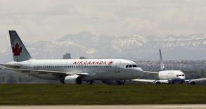 An Air Canada plane lands in front of a United plane at the Calgary International Airport in Calgary, Alberta in this June 17, 2008 file photo. REUTERS/Todd Korol
