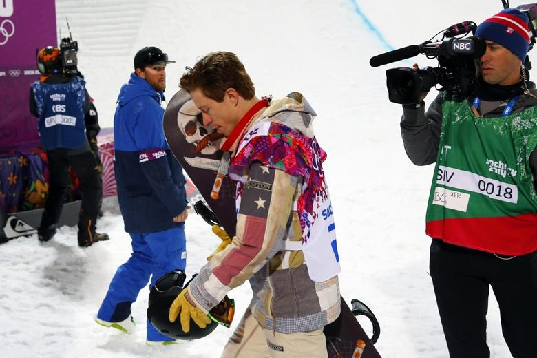 Shaun White of the U.S. walks away after failing to win a medal in the men's snowboard halfpipe qualification round at the 2014 Sochi Winter Olympic Games in Rosa Khutor February 11, 2014. REUTERS/Lucas Jackson