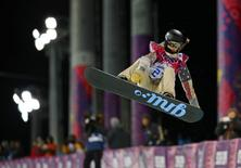Kaitlyn Farrington of the U.S. performs a jump during the women's snowboard halfpipe finals at the 2014 Sochi Winter Olympic Games in Rosa Khutor February 12, 2014. REUTERS/Mike Blake