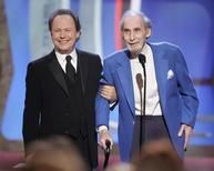 Legendary comedian Sid Caesar (R) accepts the TV Land Pioneer award presented by friend and comedian Billy Crystal (L) during a taping of the TV Land awards show March 19, 2006 in Santa Monica, California. REUTERS/Fred Prouser