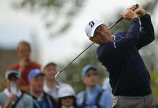 Fred Couples of the U.S. watches his tee shot on the second hole during the first round of the British Open golf Championship at Muirfield in Scotland July 18, 2013. REUTERS/Brian Snyder