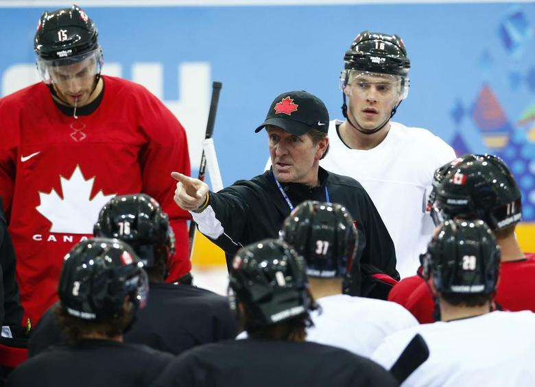 Canada's head coach Mike Babcock directs his team during their men's team ice hockey practice at the 2014 Sochi Winter Olympics, February 12, 2014. REUTERS/Mark Blinch