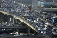Lines of cars are pictured during a rush hour traffic jam on Guomao Bridge in Beijing July 11, 2013.REUTERS/Jason Lee