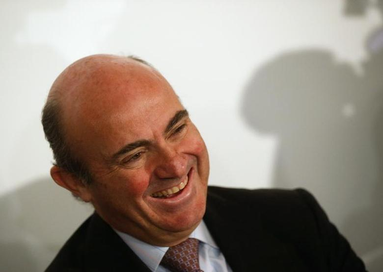 Spain's Economy Minister Luis de Guindos laughs during the meeting of the Spain Investors Day in Madrid January 15, 2014. REUTERS/Andrea Comas