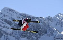Joss Christensen of the U.S. performs a jump during the men's freestyle skiing slopestyle finals at the 2014 Sochi Winter Olympic Games in Rosa Khutor, February 13, 2014. REUTERS/Dylan Martinez