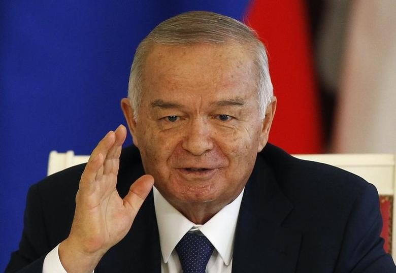 Uzbekistan's President Islam Karimov gestures during a signing ceremony after talks with his Russian counterpart Vladimir Putin at the Kremlin in Moscow, April 15, 2013. REUTERS/Grigory Dukor