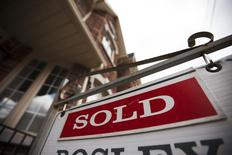 A sign indicating a house has been sold on the real estate market is seen in Toronto, April 9, 2009. REUTERS/Mark Blinch
