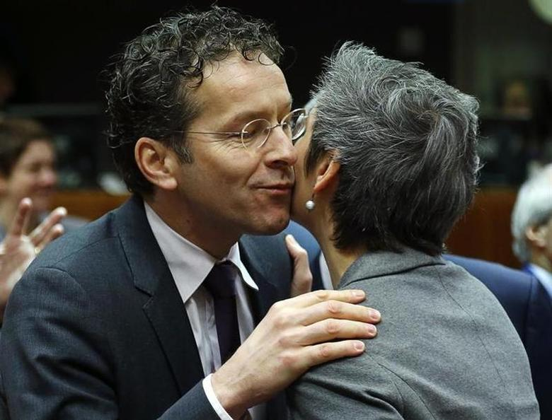Dutch Finance Minister and Eurogroup chairman Jeroen Dijsselbloem (L) embraces his Danish counterpart Margrethe Vestager during an European Union finance ministers meeting in Brussels January 28, 2014. REUTERS/Yves Herman