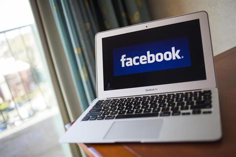 A portrait of the Facebook logo in Ventura, California December 21, 2013. REUTERS/Eric Thayer/Files