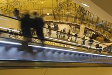 People use an escalator at a shopping mall in Essen November 30, 2013. REUTERS/Ina Fassbender