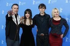 """Director, screenwriter and producer Richard Linklater and cast members Lorelei Linklater, Ellar Coltrane and Patricia Arquette (L-R) pose during a photocall to promote the movie """"Boyhood"""" during the 64th Berlinale International Film Festival in Berlin February 13, 2014. REUTERS/Tobias Schwarz"""
