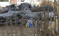 A firefighter and an emergency crew work on the site of the train wreck in Lac Megantic, July 16, 2013. REUTERS/Ryan Remiorz/Pool