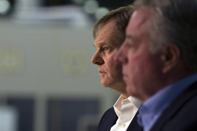 Frank Fischer (L), Volkswagen Chattanooga CEO and Chair, and Gary Casteel (R), United Auto Workers (UAW) Region 8 Director, listen as Retired Circuit Court Judge Sam Payne announces that the union lost its bid to represent the 1,550 blue-collar workers at the Volkswagen plant in Chattanooga, Tennessee February 14, 2014. REUTERS/Christopher Aluka Berry