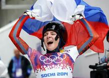 Russia's Elena Nikitina celebrates after competing in the women's skeleton event at the 2014 Sochi Winter Olympics February 14, 2014. REUTERS/Arnd Wiegmann