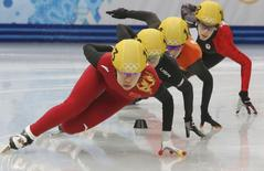 China's Zhou Yang leads as she takes a curve during a women's 1,500 metres short track speed skating heat event at the Iceberg Skating Palace during the 2014 Sochi Winter Olympics February 15, 2014. REUTERS/Alexander Demianchuk