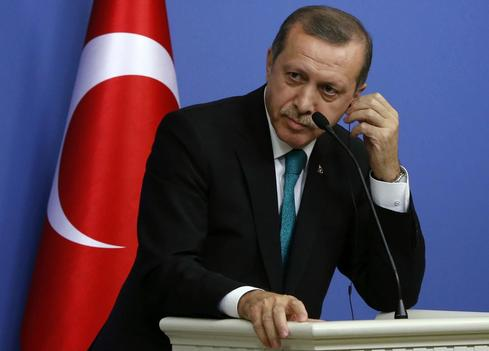 Turkish PM tightens grip on judiciary in parliament vote
