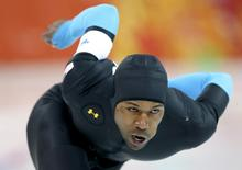 Shani Davis of the U.S. competes in the men's 1,500 metres speed skating race during the 2014 Sochi Winter Olympics, February 15, 2014. REUTERS/Issei Kato