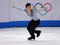Canada's Patrick Chan competes during the figure skating men's free skating program at the Sochi 2014 Winter Olympics, February 14, 2014. REUTERS/David Gray