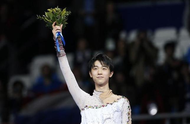 2月14日、フィギュアスケート日本男子初の五輪金メダルを獲得した羽生結弦選手。約3年前にあきらめかけた夢は、日本から約8000キロ離れたロシアのソチ五輪でついに実現した(2014年 ロイター/Alexander Demianchuk)