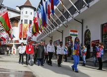 Members of India's national athletes team walk to attend the welcoming ceremony for the team in the Olympic athlete's village, which stands on a mountain plateau in Rosa Khutor, during the 2014 Winter Olympic Games February 16, 2014. REUTERS/Shamil Zhumatov