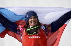First placed Eva Samkova of the Czech Republic celebrates after the women's snowboard cross finals at the 2014 Sochi Winter Olympic Games in Rosa Khutor February 16, 2014. REUTERS/Dylan Martinez