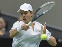 Tomas Berdych of Czech Republic hits a forehand against Marin Cilic of Croatia during their final match of the ABN AMRO tennis tournament in Rotterdam February 16, 2014. REUTERS/Paul Vreeker/United Photos