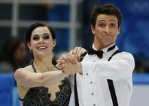Canada's Tessa Virtue and Scott Moir compete during the Figure Skating Ice Dance Short Dance Program at the Sochi 2014 Winter Olympics, February 16 2014. REUTERS/Alexander Demianchuk