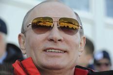 Russian President Vladimir Putin watches the cross country skiing men's relay during the Sochi 2014 Olympic Winter Olympics at Laura Cross-Country Ski and Biathlon Center near Krasnaya Polyana February 16, 2014. REUTERS/Mikhail Klimentyev/RIA Novosti/Kremlin