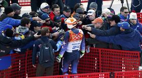 Bode Miller of the U.S. is surrounded by the media during the slalom run of the men's alpine skiing super combined event at the 2014 Sochi Winter Olympics at the Rosa Khutor Alpine Center February 14, 2014. REUTERS/Stefano Rellandini