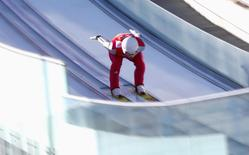 Germany's Eric Frenzel speeds down the jump during the training of the large hill ski jumping portion of the Nordic Combined individual 10 km event at the Sochi 2014 Winter Olympic Games, at the RusSki Gorki Ski Jumping Center in Rosa Khutor, February 15, 2014. REUTERS/Michael Dalder