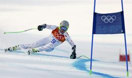 Ted Ligety of the U.S. skis during the men's alpine skiing Super-G competition at the 2014 Sochi Winter Olympics at the Rosa Khutor Alpine Center February 16, 2014. REUTERS/Ruben Sprich