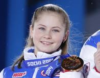Yulia Lipnitskaya of the gold medal-winning Russian figure skating team poses with her medal during the medal ceremony for the figure skating team ice dance free dance at the Sochi 2014 Winter Olympics February 10, 2014. REUTERS/David Gray