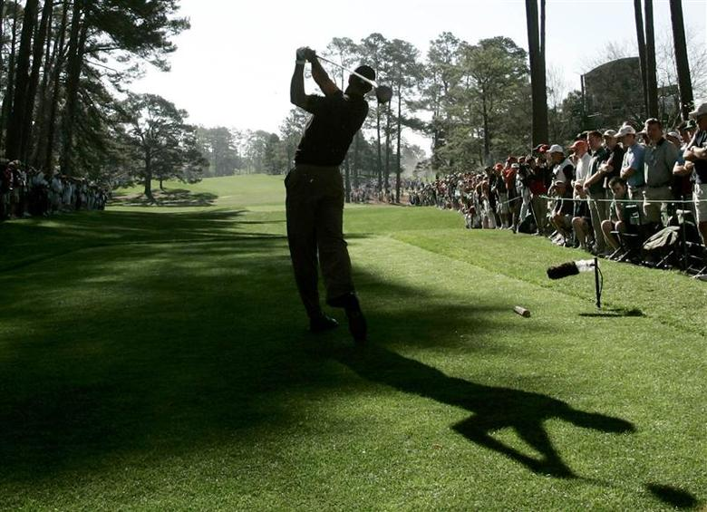 Augusta National's famed Eisenhower Tree can be seen on the left side of the fairway in this file photo of former Masters champion Tiger Woods hitting his tee shot on the 17th hole during the 2005 Masters tournament at Augusta National Golf Club in Augusta, Georgia on April 10, 2005. REUTERS/Shaun Best/Files