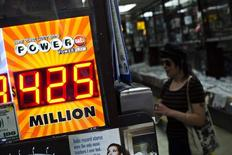 A woman buys a Powerball lottery ticket at a convenience store in New York August 7, 2013. REUTERS/Eduardo Munoz