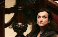 Vladimir Luxuria, who entered parliament under the Communist Refoundation party's banner, sits at the tribune of the Italian Parliament in Rome April 28, 2006. REUTERS/ Alessandro Bianchi