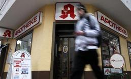 A man walks past a pharmacy in Berlin, March 17, 2010. REUTERS/Fabrizio Bensch