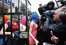Masked members of Pussy Riot leave a police station in Adler during the 2014 Sochi Winter Olympics, February 18, 2014. REUTERS/Shamil Zhumatov
