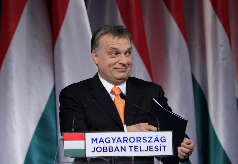 Hungarian Prime Minister Viktor Orban smiles before his annual state-of-the-nation speech in Budapest, February 16, 2014. REUTERS/Bernadett Szabo