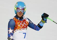 Ted Ligety of the U.S. reacts after the first run of the men's alpine skiing giant slalom event in the Sochi 2014 Winter Olympics at the Rosa Khutor Alpine Center February 19, 2014. REUTERS/Kai Pfaffenbach