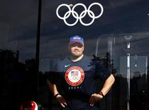 U.S. bobsled pilot Steve Holcomb poses for a picture at the fitness center in the Coastal Cluster Olympic Village in Sochi, February 4, 2014. REUTERS/Eric Gaillard