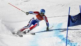 France's Steve Missillier skis during the second run of the men's alpine skiing giant slalom event at the 2014 Sochi Winter Olympics at the Rosa Khutor Alpine Center February 19, 2014. REUTERS/Ruben Sprich