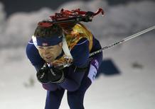 Norway's Ole Einar Bjoerndalen skis during the mixed biathlon relay at the Sochi 2014 Winter Olympics February 19, 2014. REUTERS/Sergei Karpukhin